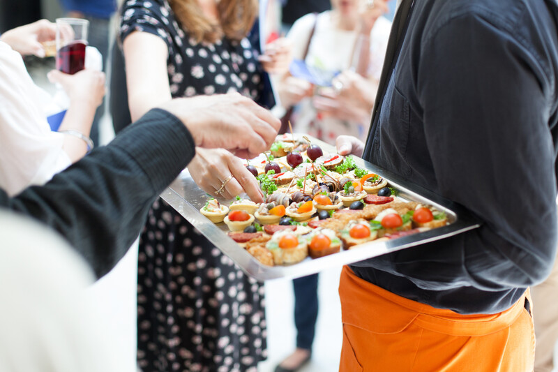 waiter doing catering service at social gathering