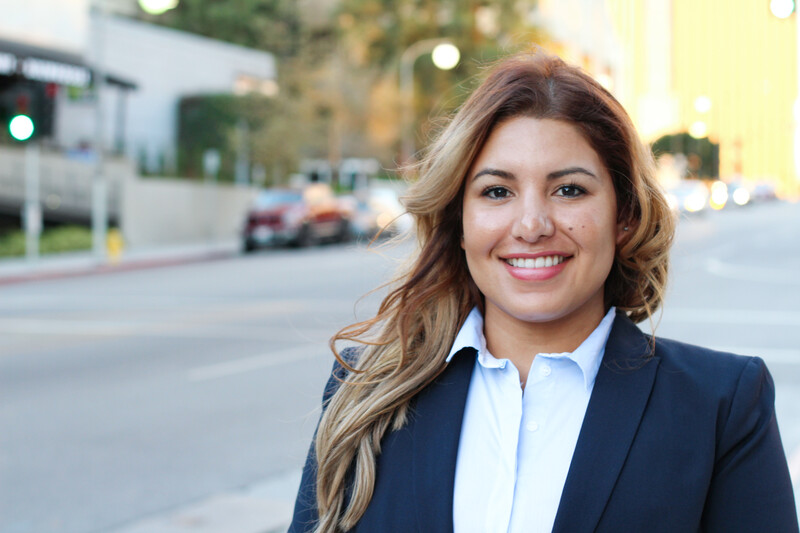 Beautiful smiley confident businesswoman portrait on the street