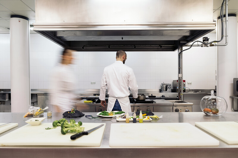 Two professionals chefs cooking together.